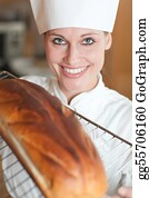 Sense-Of-Smell - Smiling Female Chef Baking Bread