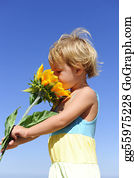 Sense-Of-Smell - Cute Child Smelling A Sunflower