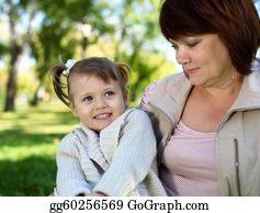 Granddaughter - Grandmother With Her Little Granddaghter In Park