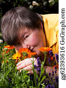 Sense-Of-Smell - Disabled Woman Lying On Grass And Smell Of Flowers