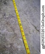 Millimeter - Construction Measuring Tape On Grunge Concrete