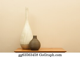Tall-And-Short - Tall White Vase And Short Striped Vase On Small Table
