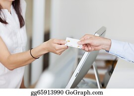 Health-Insurance-Card - Receptionist Receiving Card From Male Patient In Dentist Clinic