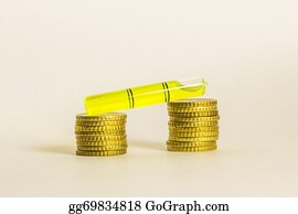 Tall-And-Short - Yellow Coins Lined Up From Short To Tall Stacks With White Background