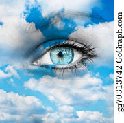 Eyelid - Beautiful Blue Eye Against Blue Clouds - Spiritual Concept