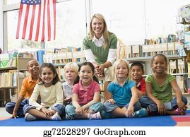 Teacher - Kindergarten Teacher Sitting With Children In Library
