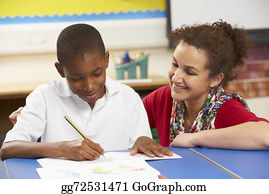Teacher - Schoolboy Studying In Classroom With Teacher