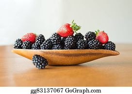 Boysenberry - Mix Of Berries On Wooden Plate